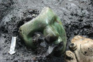 A green mask found in Mexico's Pyramid of the Sun