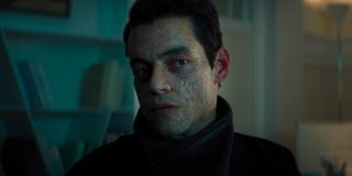 Rami Malek looks cooly to the side in No Time To Die.