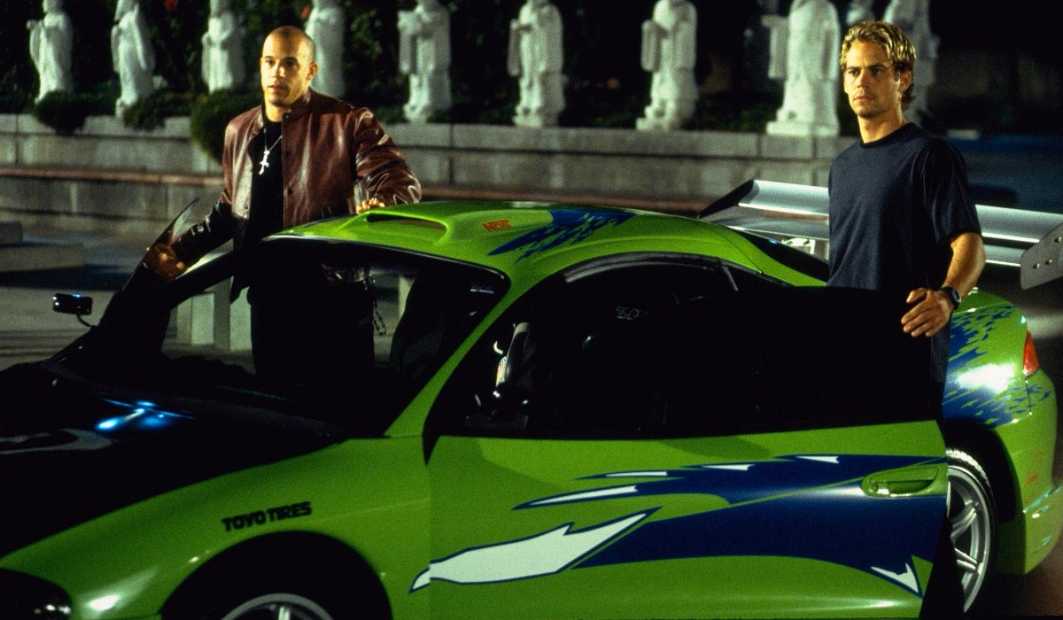 The Fast and Furious Vin Diesel and Paul Walker get out of a lime green street racer