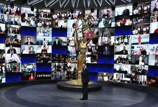 Jimmy Kimmel stands in front of the live feeds of the 2020 Emmy nominees.