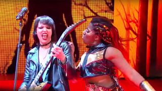 Lzzy Hale performing live with Ember Moon