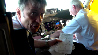 A still of Bruce Dickinson from the Ed Force One video