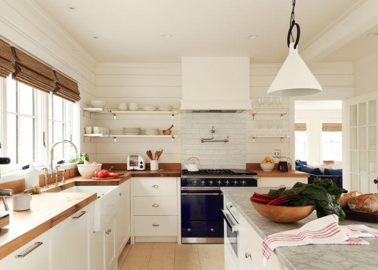 Modern white kitchen with wooden worktops and kitchen island