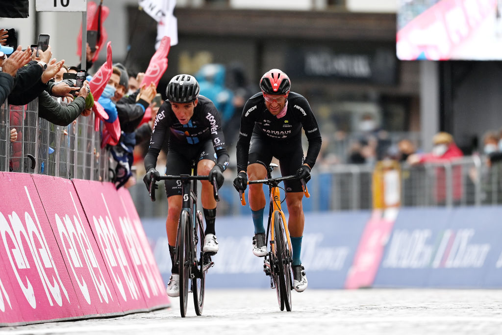 CORTINA DAMPEZZO ITALY MAY 24 Romain Bardet of France and Team DSM Damiano Caruso of Italy and Team Bahrain Victorious at arrival during the 104th Giro dItalia 2021 Stage 16 a 153km stage shortened due to bad weather conditions from Sacile to Cortina dAmpezzo 1210m girodiitalia Giro on May 24 2021 in Cortina dAmpezzo Italy Photo by Stuart FranklinGetty Images