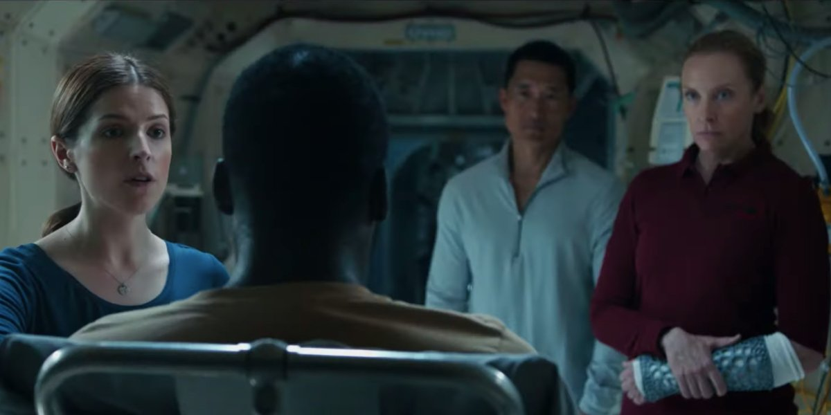 Anna Kendrick, Daniel Dae Kim, and Toni Collette circle around Shamier Anderson in Stowaway.