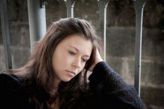 A sad-looking teen girl