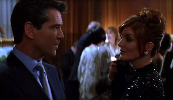 The Thomas Crown Affair Pierce Brosnan has a friendly chat with Rene Russo at an art show