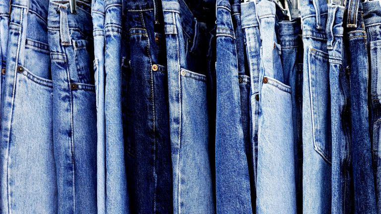 different types of jeans on rack