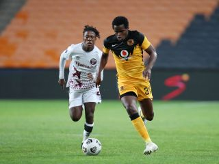 Willard Katsande of Kaizer Chiefs challenged by Kgaogelo Sekgota of Swallows FC