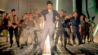 "The cast on the set of ""Aliens,"" Ripley (Sigourney Weaver) sporting her signature high-tops."