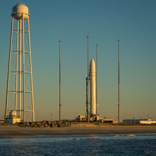 An Orbital Sciences Corporation Antares rocket is seen on launch Pad-0A during sunrise at NASA's Wallops Flight Facility on Wallops Island, Va., on Jan. 8, 2014 after its planned launch was delayed a day due to solar radiation concerns from a huge solar f