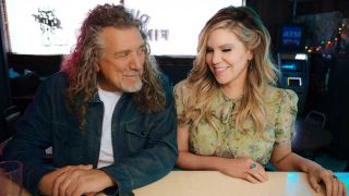 Robert Plant and Alison Krauss sitting at a diner counter