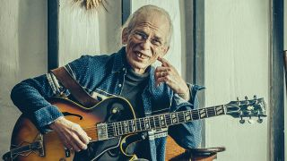 Steve Howe grinning with his acoustic guitar, 2016