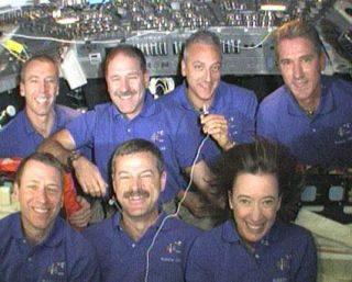 Astronauts Conserve Power for Potential Landing Delay