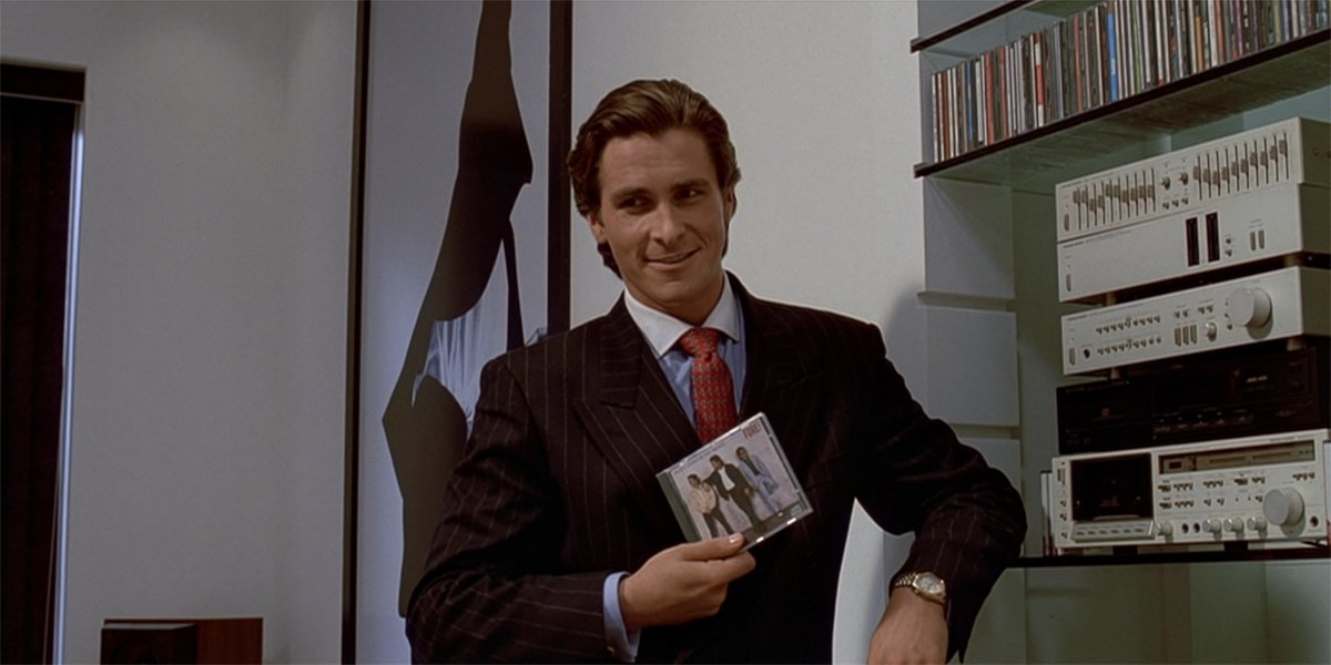 American Psycho Christian Bale as Patrick Bateman with Huey Lewis album