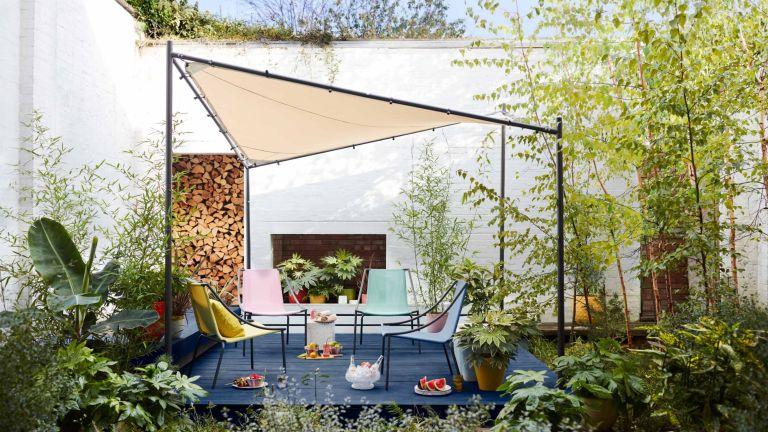 A contemporary sail shade gazebo over a modern garden seating area