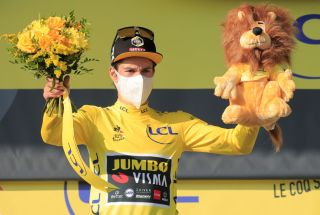 Team Jumbo rider Slovenias Primoz Roglic celebrates his overall leader yellow jersey on the podium at the end of the 15th stage of the 107th edition of the Tour de France cycling race 175 km between Lyon and Grand Colombier on September 13 2020 Photo by Christophe Petit Tesson POOL AFP Photo by CHRISTOPHE PETIT TESSONPOOLAFP via Getty Images
