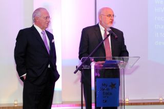 Dr. Robert Redfield Jr. (right) speaks during AIDS gala in 2013 in New York City.