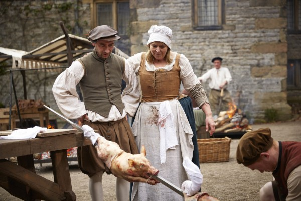 Charlie Condou and Fern Britton with a hog roast
