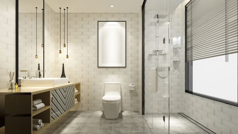 Best toilet seat: a modern bathroom with a large vanity unit, a white toilet and a great toilet seat.