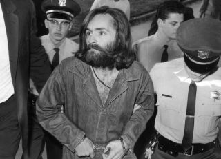 Charles Manson is escorted to court for a preliminary hearing on Dec. 3, 1969, in Los Angeles, California.