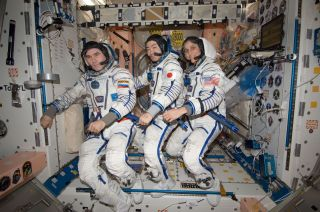 Space Station's Expedition 33 crew suits up in Sokol suits ahead of landing.