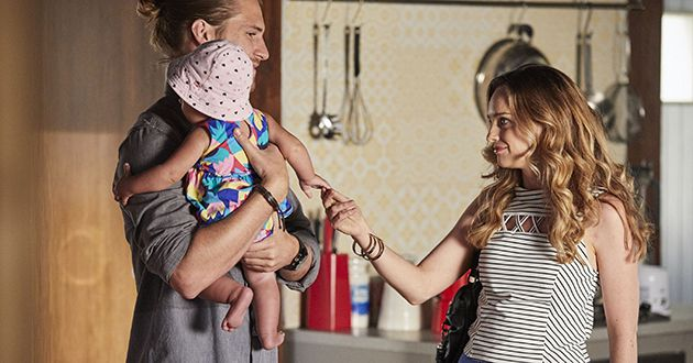 Tori Morgan plays with baby Luc while talking to Ash Ashford in Home And Away.