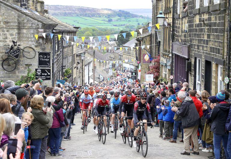 The 2019 Tour de Yorkshire riding up Haworth Main Street