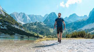 A man hiking between mountains