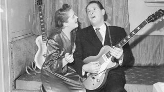 16th September 1952: guitarist Les Paul serenades his wife and singing partner Mary Ford
