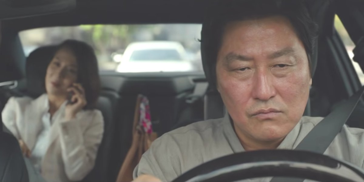 Kim Ki-taek (Song Kang-ho) drives Choi Yeon-gyo (Cho Yeo-jeong) in Parasite