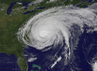 This GOES-13 satellite photo shows Hurricane Irene, a Category 1 storm, 2 hours after it made landfall at Cape Lookout, N.C., on Aug. 27, 2011. This image was taken at 10:10 a.m. ET.