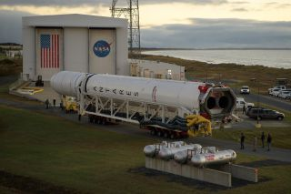 The Northrop Grumman Antares rocket that will launch the Cygnus NG-12 cargo resupply mission to the International Space Station rolls out of the Horizontal Integration Facility to the launch site at NASA's Wallops Flight Facility in Virginia on Oct. 29, 2019.