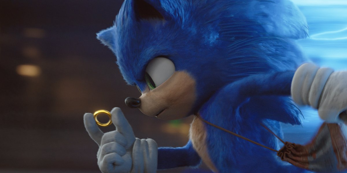 Sonic The Hedgehog running with coin
