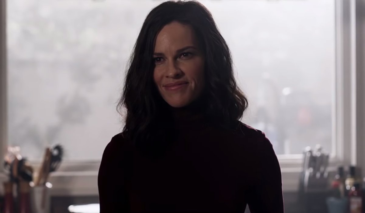The Hunt Hilary Swank smirking in the kitchen