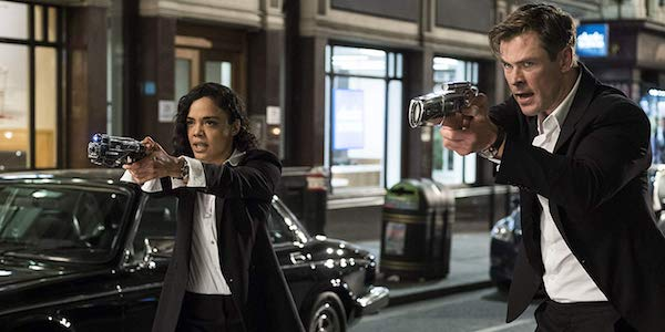 Tessa Thompson and Chris Hemsworth as Agent M and Agent H in Men in Black: International