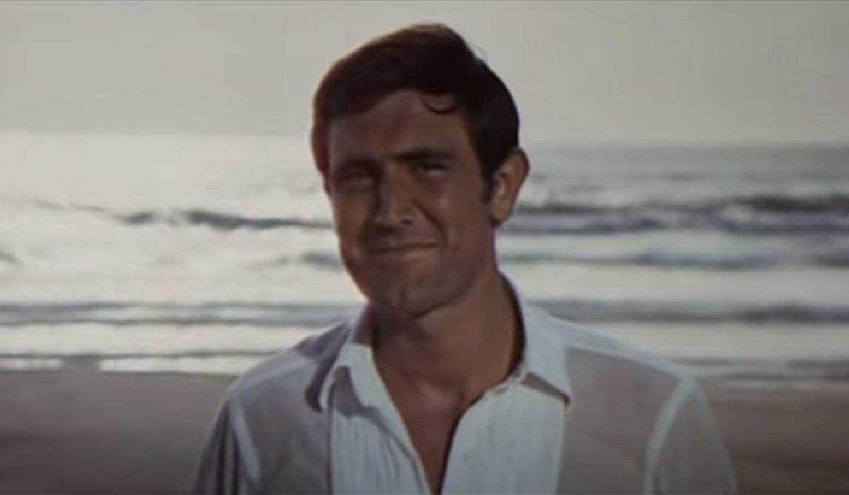On Her Majesty's Secret Service George Lazenby smirks on the beach