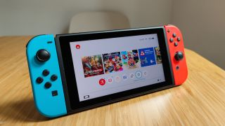 The Nintendo Switch on a wooden table top
