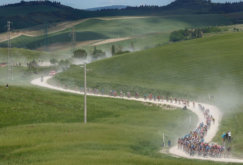 The pack rides through the countryside during the eleventh stage of the Giro dItalia 2021 cycling race 162 km between Perugia and Montalcino on May 19 2021 Photo by Luca Bettini AFP Photo by LUCA BETTINIAFP via Getty Images