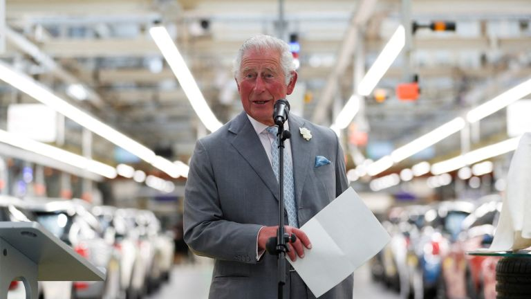 Prince Charles, Prince of Wales, makes a speech on th production line to employees during his visit to the MINI plant in Oxford on June 8, 2021