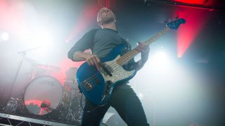 Taking Back Sunday bassist Shaun Cooper performs live