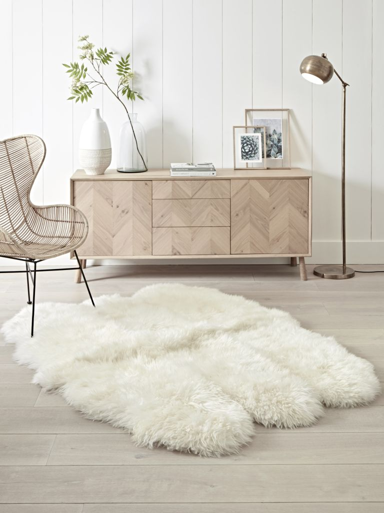 fluffy sheepskin rug in living room with neutral scheme