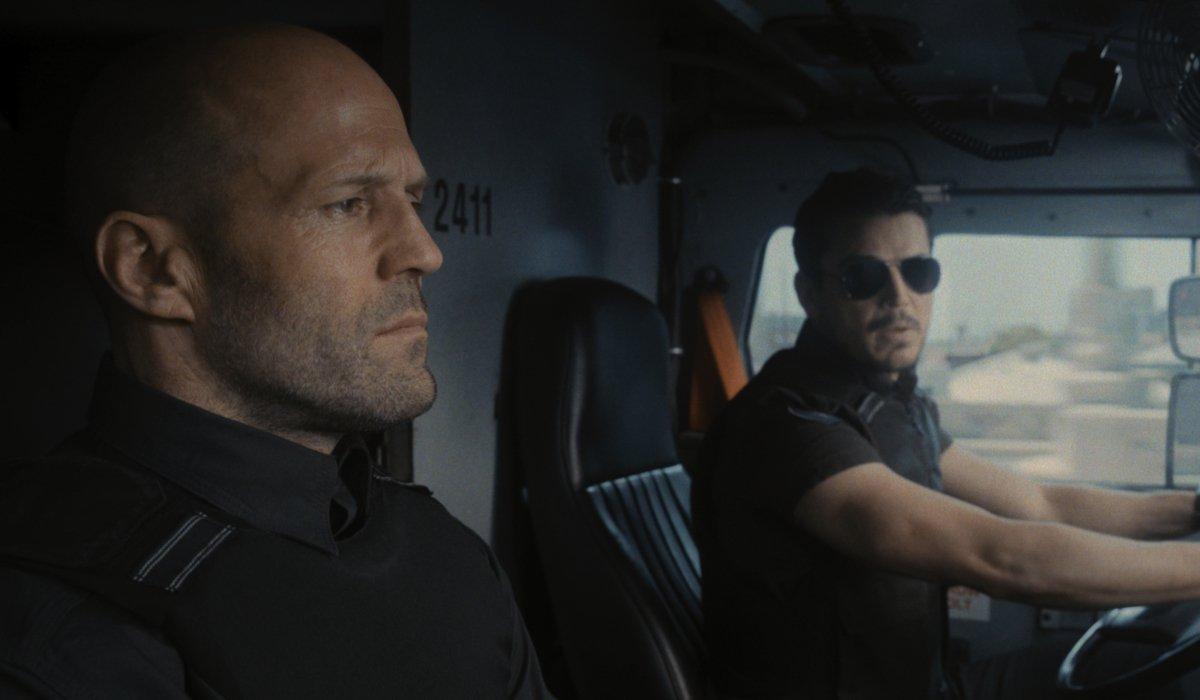 Jason Statham and Josh Hartnett in their armored truck in Wrath of Man.