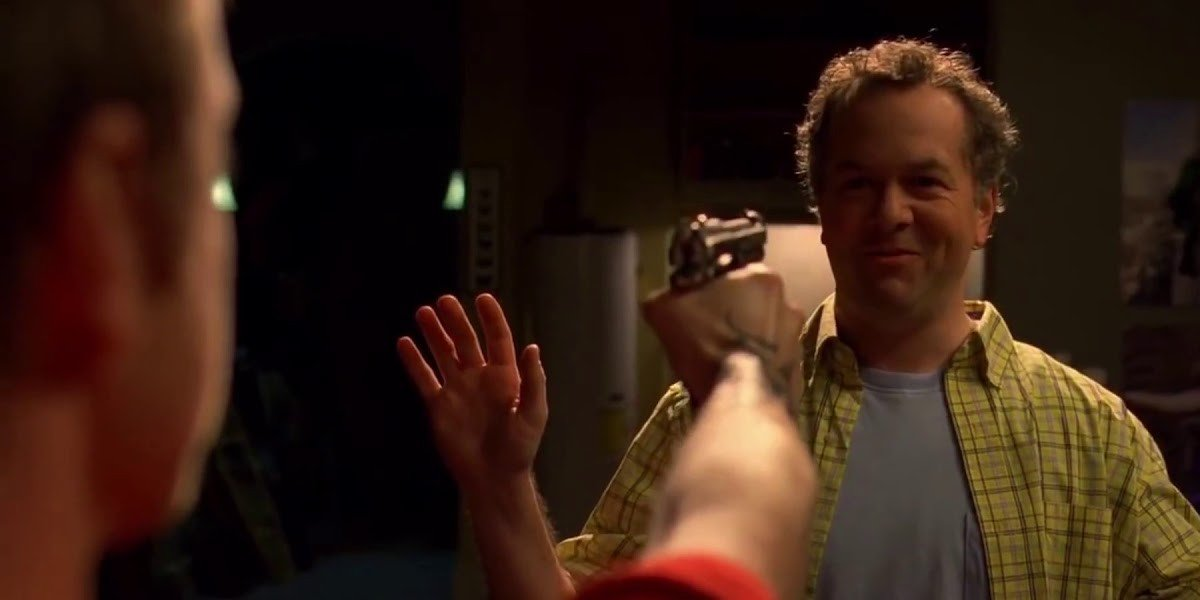 Aaron Paul with the gun, David Costabile with his hands up