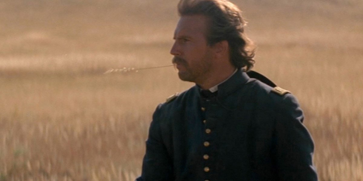 Kevin Costner stands in a field in Dances with Wolves