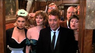 Tim Curry and the 'Clue' ensemble.
