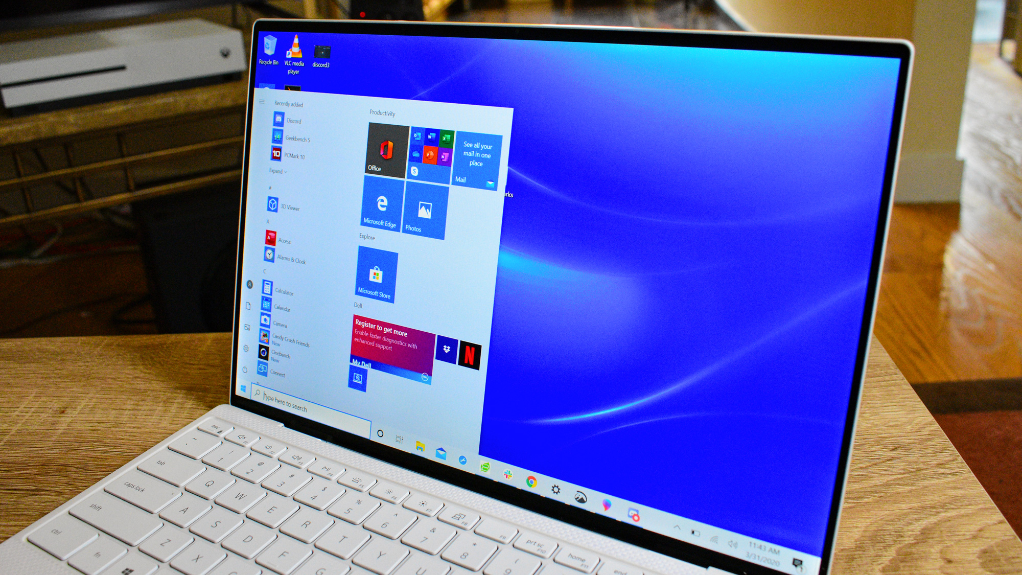 The Dell XPS 13 (2020) showcasing its screen on a coffee table