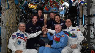 Expedition 65 astronauts celebrate the kick-off of the 2020 Paralympic Games with a torch ceremony aboard the International Space Station.