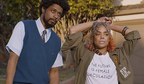 Sorry To Bother You Lakeith Stanfield Tessa Thompson standing around looking bored