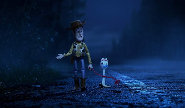 Toy Story 4 Woody and Forky walking down the highway